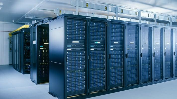 rows of black server racks inside a datacenter