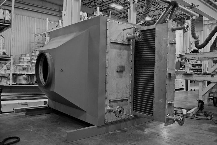 Large industrial economizer assembly with heat exchanger pulled out