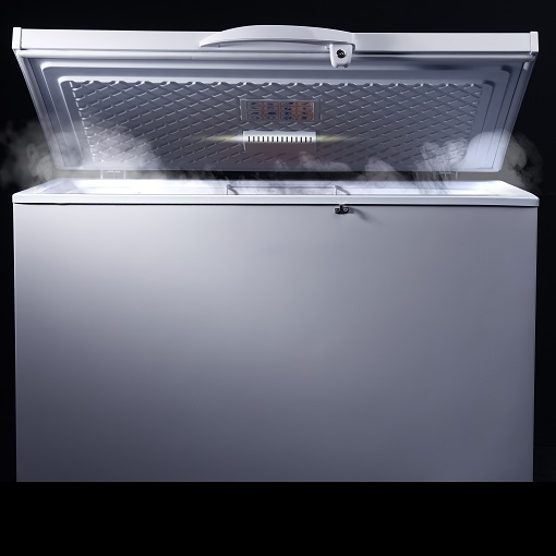 deep freezer with lid open against black background