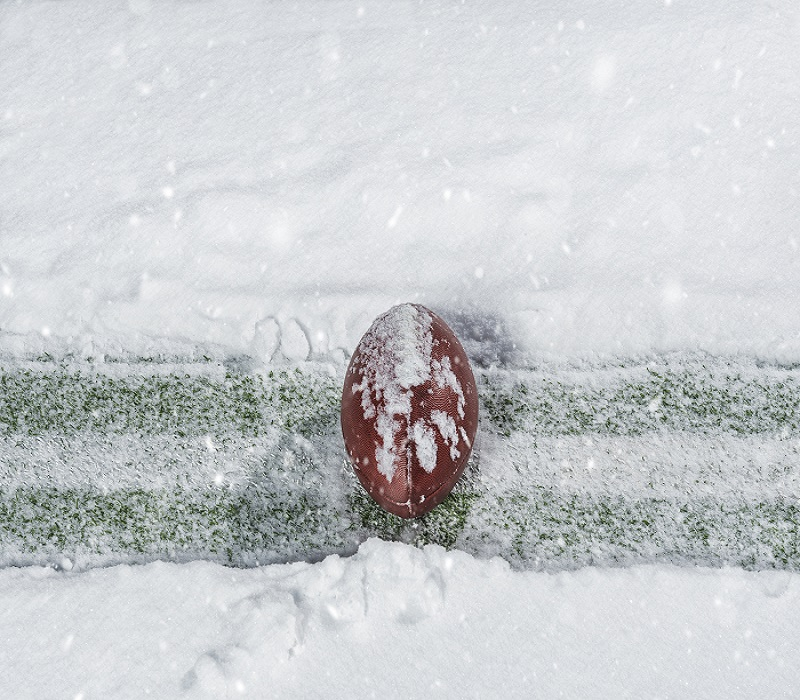 frozen football field with yard line and football