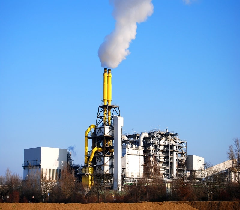 incineration plant with smoke coming from smokestack on a clear day